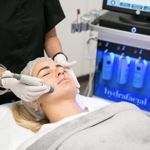 female patient during hydrafacial treatment