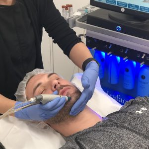 male hydrafacial patient at infinity clinic
